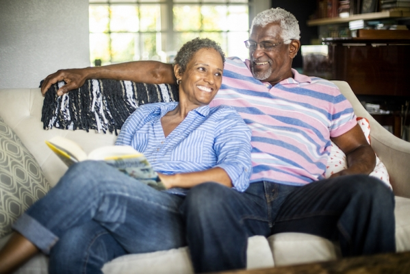 Senior Black Man and his Wife Reading a Book